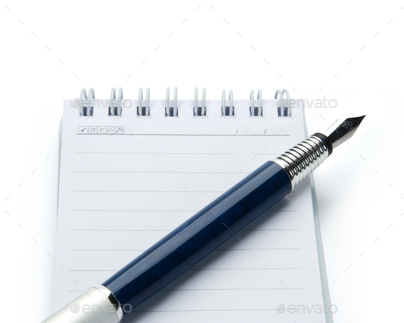 Pen on notebook, isolated on white background. - Stock Photo - Images