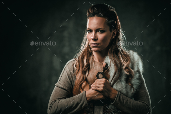 Viking woman with cold weapon in a traditional warrior clothes - Stock Photo - Images