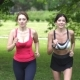 Girls Jogging in the Park. Girlfriends Go in for Sports Together.