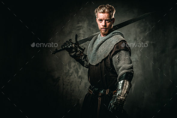 Medieval knight with sword and armour - Stock Photo - Images