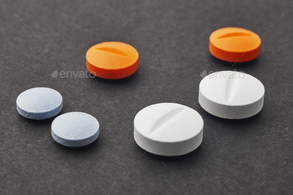 Pills over a black background. Medicament treatment. Health care photo - Stock Photo - Images
