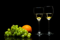 Glasses for wine, grapes and oranges on a black background - PhotoDune Item for Sale