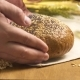 Bread Sprinkled with Sunflower Seeds Is Put on the Table - VideoHive Item for Sale