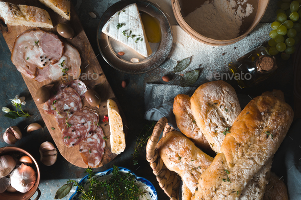 Homemade bread, sausage, cheese, fruit on the table - Stock Photo - Images