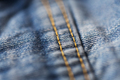 close up of stitching on denim or jeans clothes