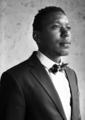 African Descent Groom in Navy Blue Tuxedo Wedding Marriage Cerem