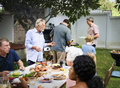 Group of diverse people enjoying barbecue party together - PhotoDune Item for Sale