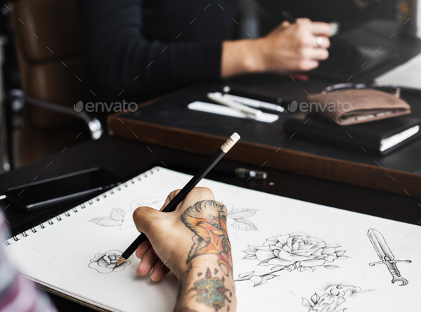 580431297 Closeup of tattooed hand with drawing artwork Stock Photo by Rawpixel