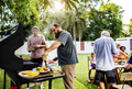 Diverse people enjoying barbecue party together - PhotoDune Item for Sale