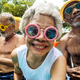 Download Closeup of diverse senior adults sitting by the pool enjoying su from PhotoDune