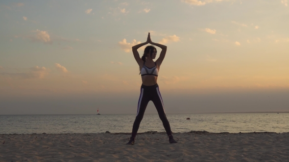 Beautiful Young Woman in Sportswear Practicing Yoga Outdoors