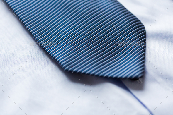 close up of shirt and blue patterned tie - Stock Photo - Images