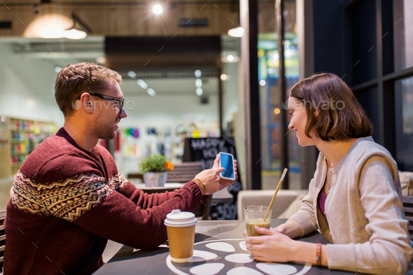 happy couple with smartphone and drinks at cafe - Stock Photo - Images