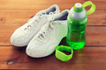 close up of sneakers, bracelet and water bottle