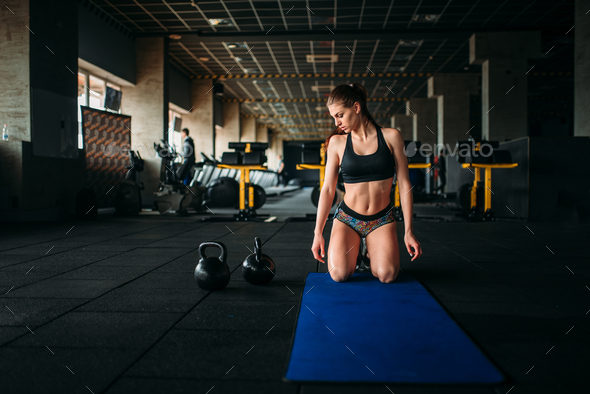 Female athlete trains press in sport gym, top view - Stock Photo - Images