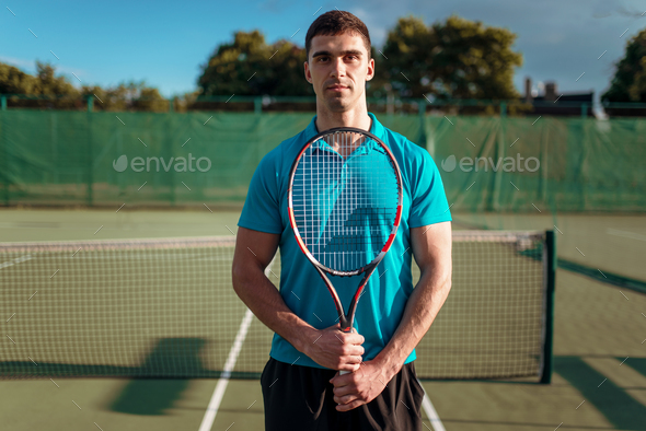 Athletic male tennis player plays on outdoor court - Stock Photo - Images