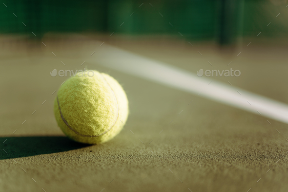 Tennis ball on ground coverage closeup - Stock Photo - Images