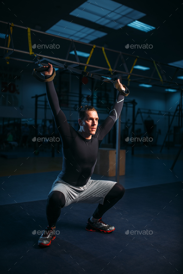 Sportsman on training,endurance workout with ropes - Stock Photo - Images