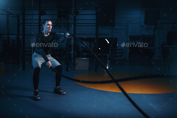Sportsman on training, workout with battle ropes - Stock Photo - Images