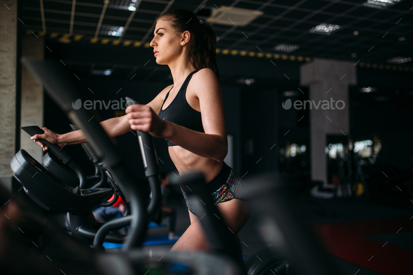 Female athlete exercise on treadmill in sport gym - Stock Photo - Images