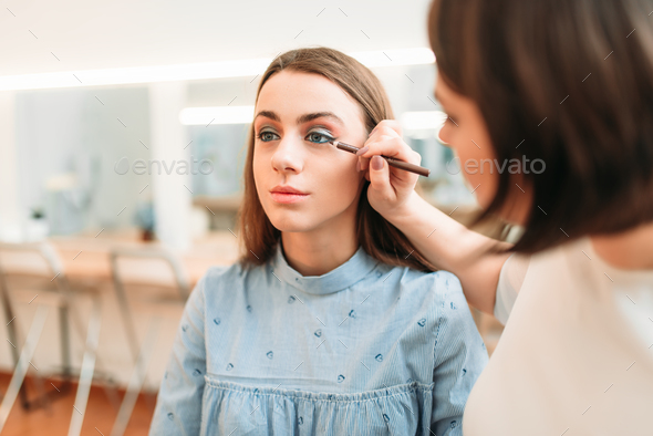 Professional beautician work with woman eyes - Stock Photo - Images