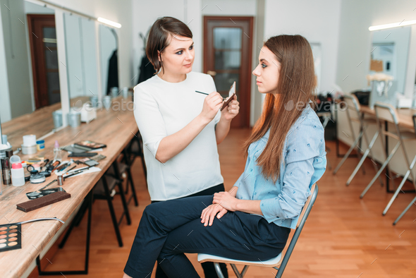 Professional makeup artist work with glamour woman - Stock Photo - Images
