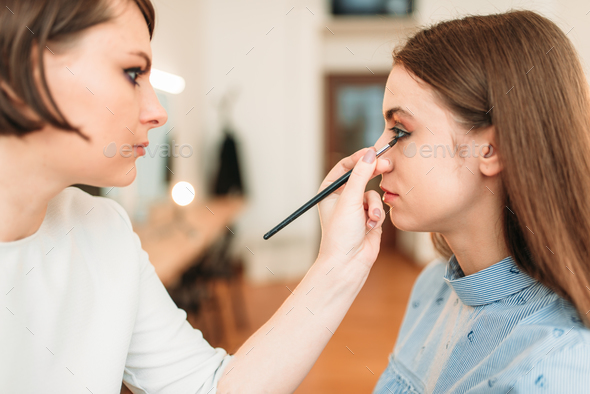 Female make up artist work with woman face - Stock Photo - Images
