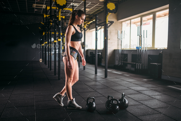 Slim woman posing with weight in fitness club - Stock Photo - Images