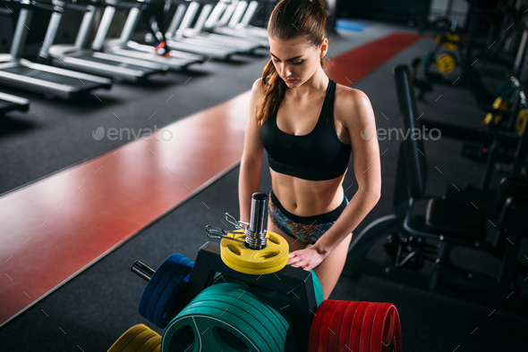 Athletic woman in sportswear, sport gym - Stock Photo - Images