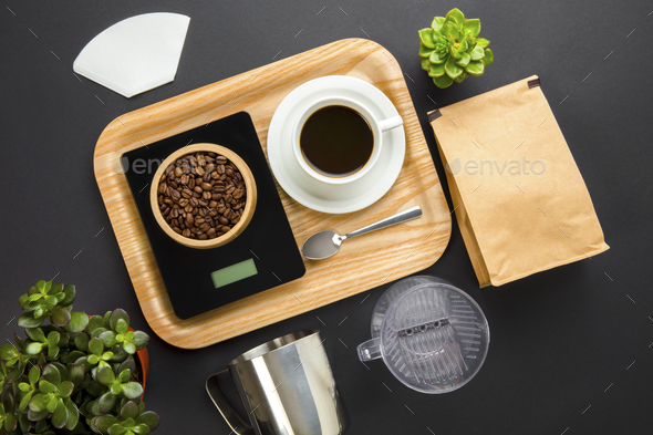 Roasted Beans On Weight Scale With Coffee Cup In Tray - Stock Photo - Images