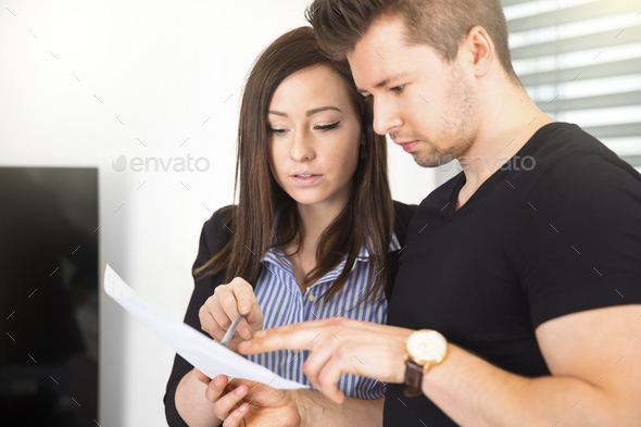 Business People Reading Document In Office - Stock Photo - Images