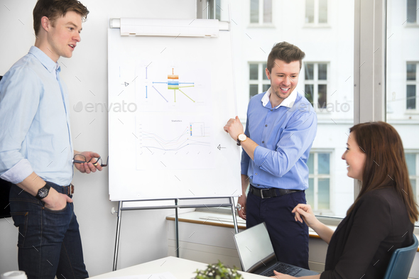 Cheerful Businessmen Looking At Female Colleague In Meeting - Stock Photo - Images