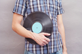 Man holds vinyl record in his hand - PhotoDune Item for Sale