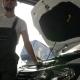 Portrait Machine Mechanic in Backlight Near Opens Bonnet, Worker Auto Repair, Mechanician, Master on Nulled