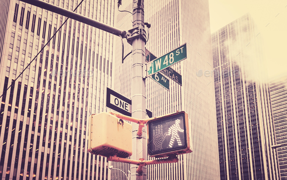 Retro stylized crosswalk signal and traffic sign post in NYC. - Stock Photo - Images