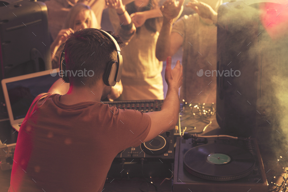 DJ warming up the audience - Stock Photo - Images