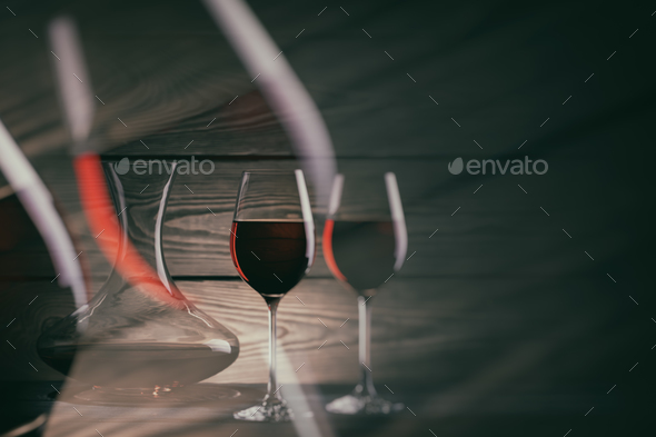 Two glasses and decanter of red wine on a dark background - Stock Photo - Images