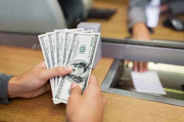 hands with money at bank office or exchanger - Stock Photo - Images