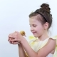 Portrait, a Pretty Cute Little Girl Plays with a Small Yellow Duckling
