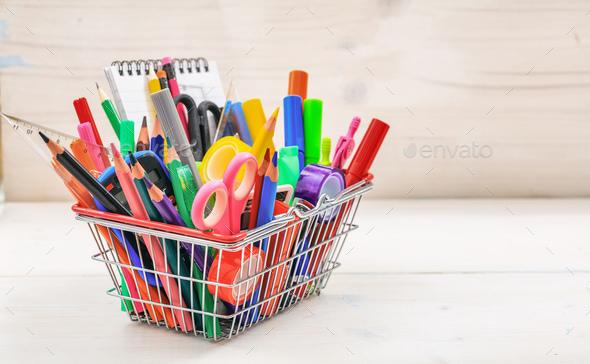School shopping basket on white background - Stock Photo - Images