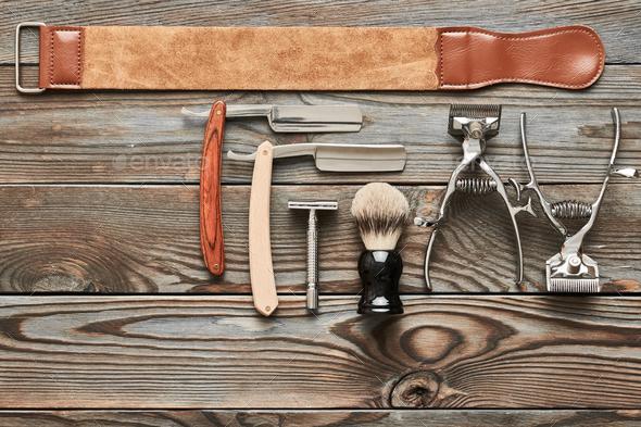Vintage barber shop tools on wooden background - Stock Photo - Images