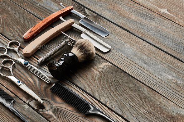 Vintage barber shop tools on wooden background - Stock Photo - Images