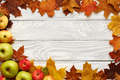 Autumn leaves and apples over old wooden background - PhotoDune Item for Sale