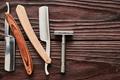 Vintage barber shop razor tools on wooden background - PhotoDune Item for Sale