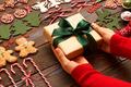 Woman holding christmas present - PhotoDune Item for Sale