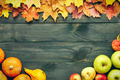 Autumn leaves, apples and pumpkins over wooden background - PhotoDune Item for Sale