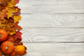 Autumn leaves and pumpkins over old wooden background - PhotoDune Item for Sale
