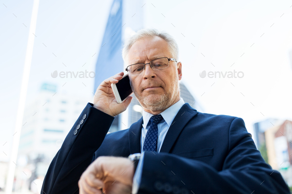 senior businessman calling on smartphone in city - Stock Photo - Images