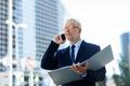 senior businessman calling on smartphone in city - PhotoDune Item for Sale