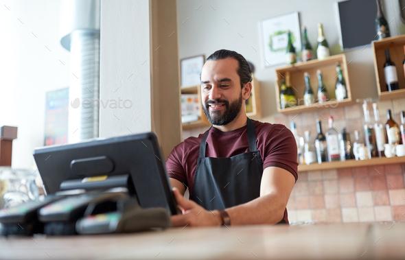 happy man or waiter at bar cashbox - Stock Photo - Images